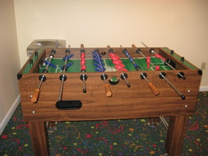 Enjoy a game of fooseball.