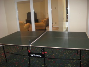 Try your backhand at table tennis. :-)