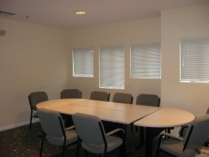 Our meeting space seats up to 12 at the table.  Additional chairs can be placed around if needed.